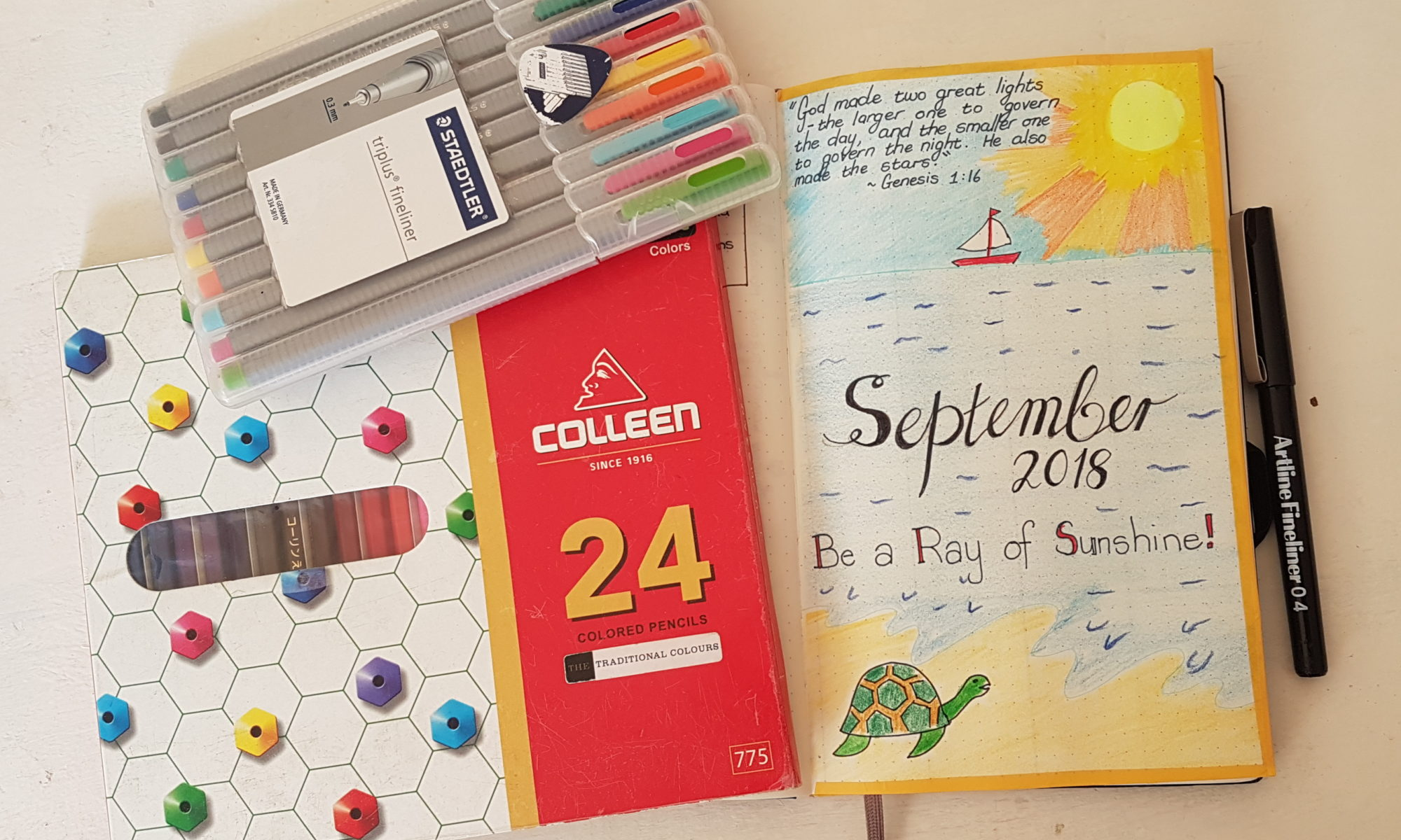 Hello September 2018 - Bullet Journal Setup - Be a ray of Sunshine - drawing of a sun, sea and turtle | AuthenticallyAsh.com