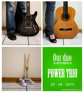 "Dad with an electric guitar, mom with an acoustic guitar. Baby shoes with drumsticks and the words ""Our Duo is becoming a Power Trio""."